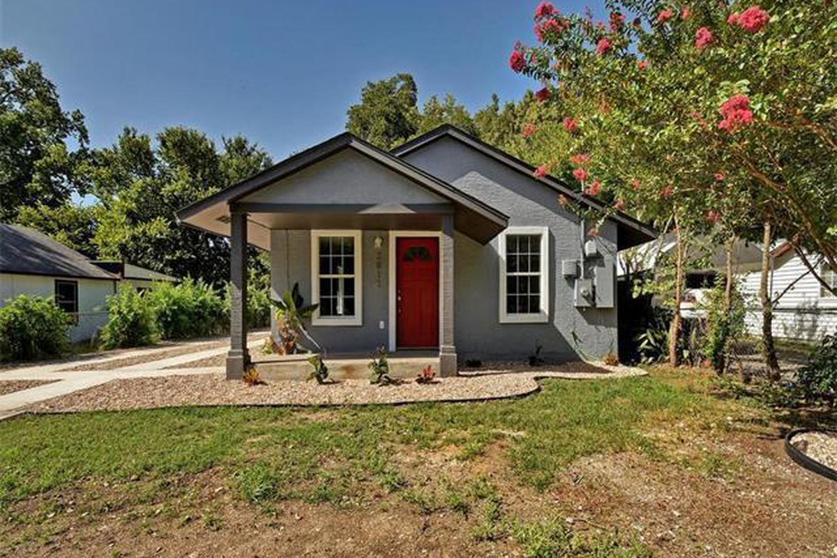 Small gray house with red door