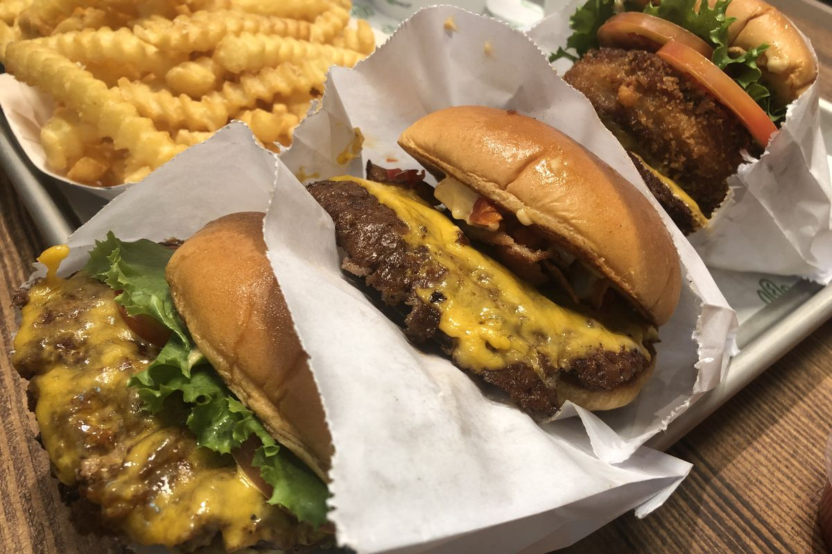 Shake Shack burgers and fries on a tray
