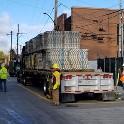 Construction material being unloaded from a truck