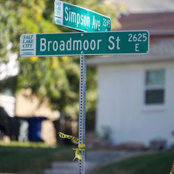 Caution tapes tied on a street sign of the shooting scene in the 2200-block of South Broadmoor st in Salt Lake City where one person died on scene and another was transported to the hospital in critical condition, Saturday, Sept. 25, 2021.