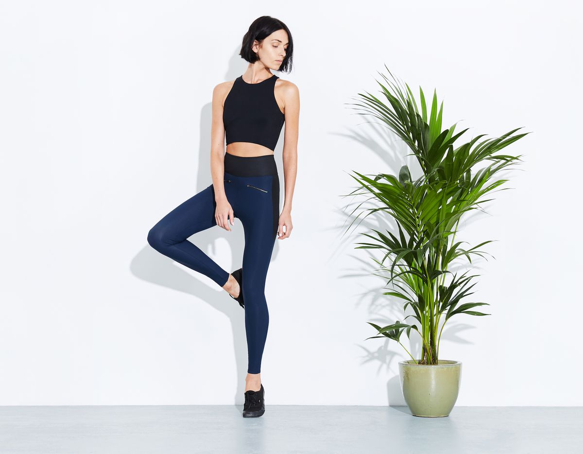 A model in ADAY leggings and tank top