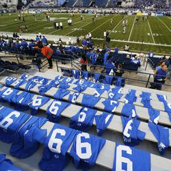 Brigham Young Cougars fans are given Jim McMahon shirts prior to the game in Provo Friday, Oct. 3, 2014. McMahon will have his jersey retired at halftime.