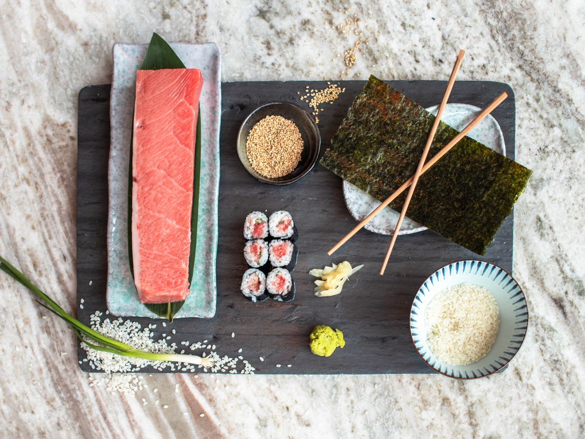 black tray with arrangement of sushi