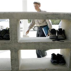 A boy collects his shoes after leaving school on the Yearning for Zion Ranch on March 23. FLDS members take off their shoes before going into any building on the ranch.