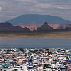 Houseboats sit at Wahweap Marina in Lake Powell, September 1997. There has been debate on whether recreation areas and national parks in Utah should be opened and run by the state during the federal government shutdown.