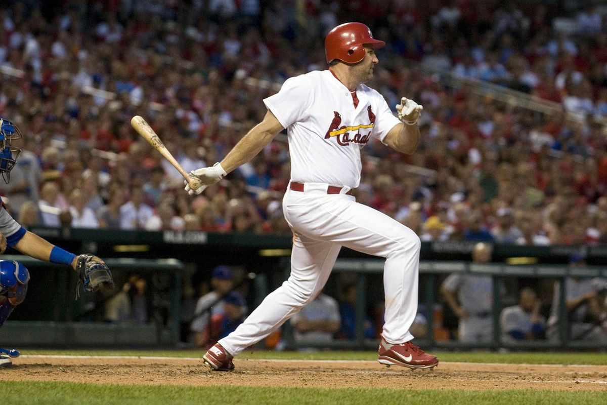 May 14, 2012; St. Louis, MO. USA; St. Louis Cardinals first baseman Lance Berkman (12) hits a one run single in the sixth inning against the Chicago Cubs at Busch Stadium. Mandatory Credit: Jeff Curry-US PRESSWIRE