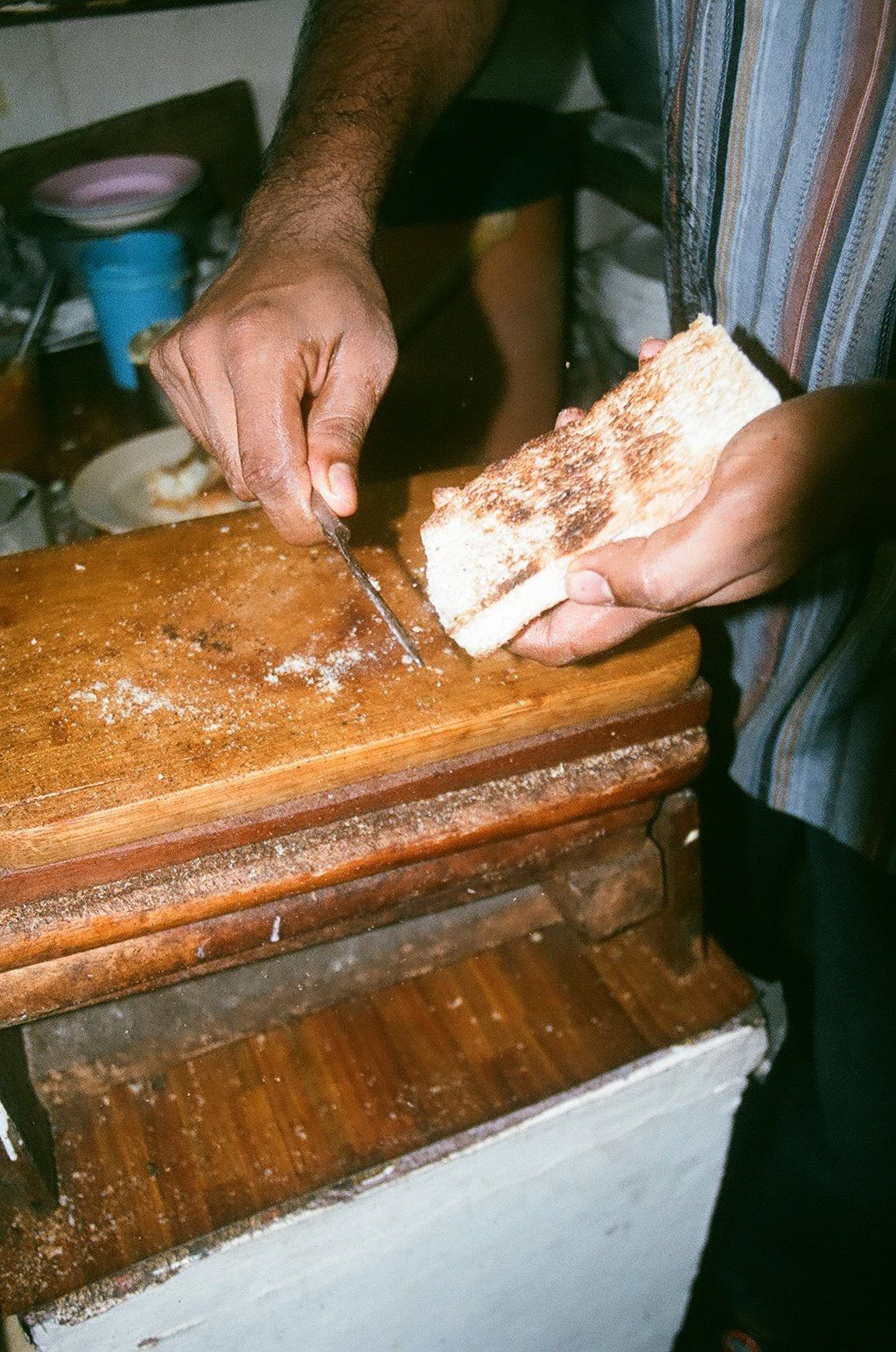 Scraping the grilled bread for kaya toast