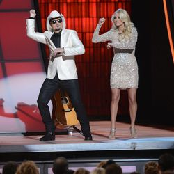Hosts Brad Paisley and Carrie Underwood demonstrate the origins of the Gangnam Style dance