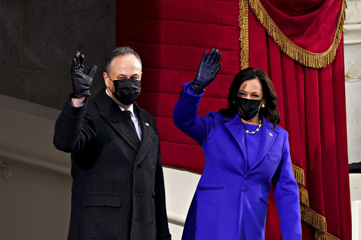 Vice President-elect Senator Kamala Harris (R) and husband Douglas Emhoff wave while arriving to the 59th presidential inauguration on January 20, 2021, at the US Capitol in Washington, DC