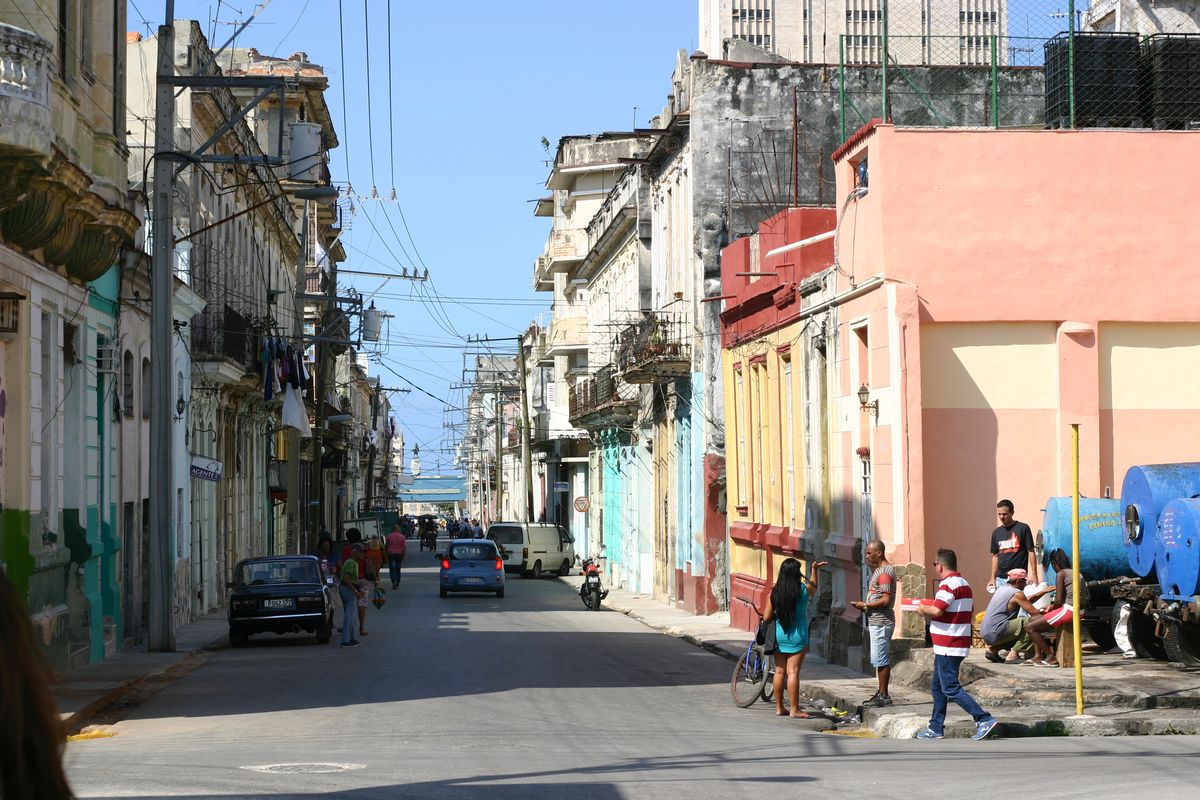 A web of cables and wires stretches across Havana's colorful streets
