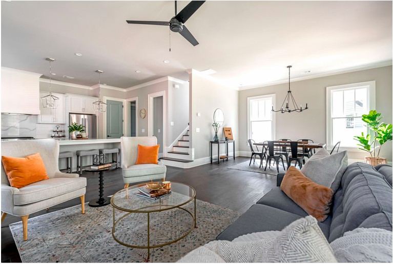 A white living and dining room space in a new house.
