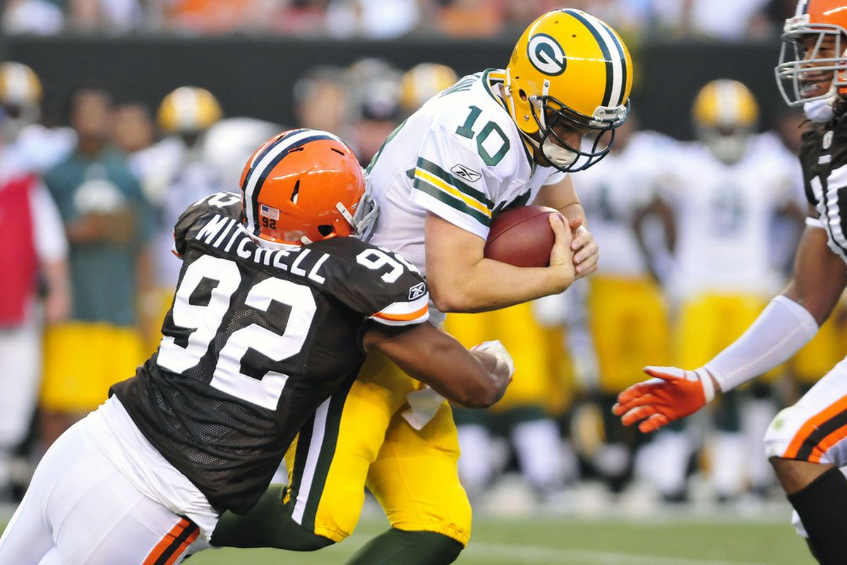 CLEVELAND, OH - AUGUST 13: Jayme Mitchell #92 of the Cleveland Browns sacks Matt Flynn #10 of the Green Bay Packers during the second quarter at Cleveland Browns Stadium on August 13, 2011 in Cleveland, Ohio. (Photo by Jason Miller/Getty Images)