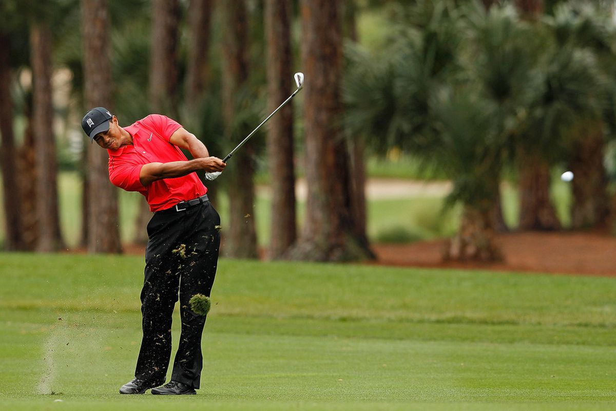 PALM BEACH GARDENS, FL - MARCH 04:  Tiger Woods hits his approach on the third  hole during the final round of the Honda Classic at PGA National on March 4, 2012 in Palm Beach Gardens, Florida.  (Photo by Mike Ehrmann/Getty Images)