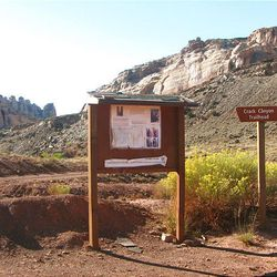 1. Hikers can park by the sign at the Crack Canyon Trailhead and start hiking the dirt road into Crack Canyon.