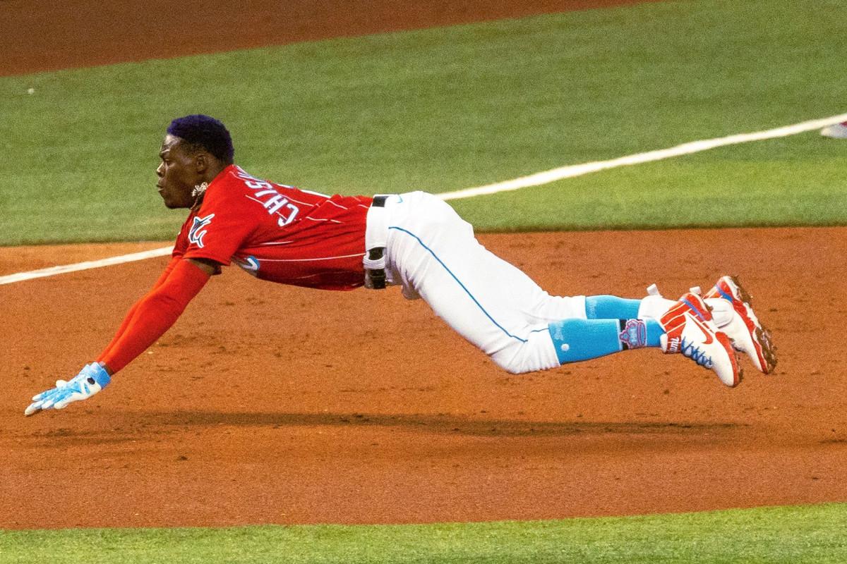 Jazz Chisholm Jr. dives into third base safely