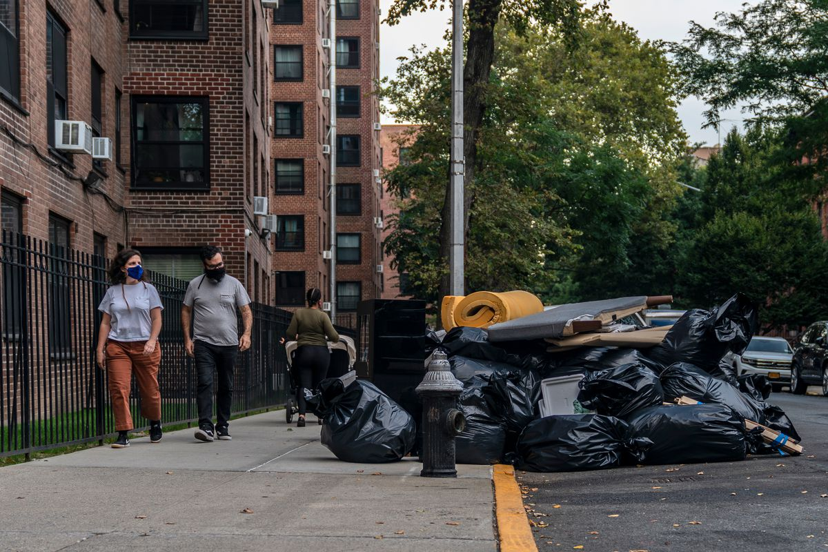 Piles of trash and tossed out furniture line a street in Clinton Hill, Brooklyn, Sept. 25, 2020.