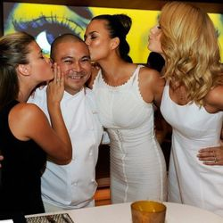Sports Illustrated swimsuit models Nina Agdal, Chrissy Teigen and Kate Bock plant kisses on Andrea's executive chef Joseph Elevado. Photo: David Becker/WireImage
