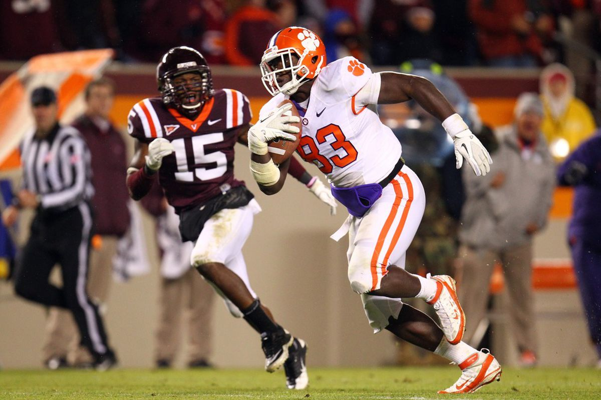 Dwayne Allen (83) of the Clemson University Tigers runs for a touchdown after a catch against Eddie Whitley (15) of the Virginia Tech University Hokies on October 1, 2011 at Lane Stadium in Blacksburg, Virginia. (Photo by Ned Dishman/Getty Images)