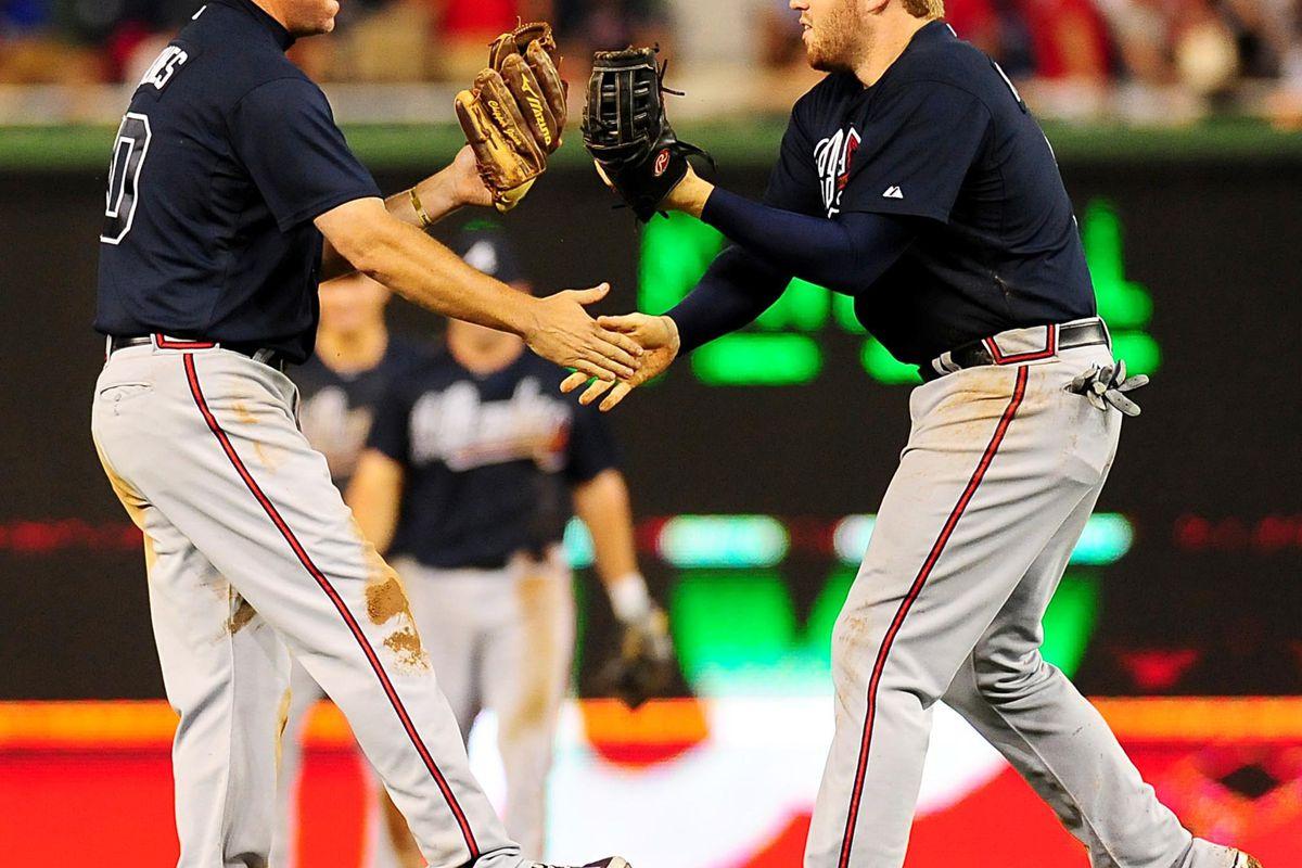 July 20, 2012;Washington, D.C. USA; Atlanta Braves third baseman Chipper Jones (10) celebrates with first baseman Freddie Freeman (5) after beating the Washington Nationals 11-10 at Nationals Park. Mandatory Credit: Evan Habeeb-US PRESSWIRE