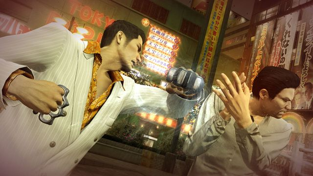 Kirya punches a thug in a screenshot from Yakuza 0