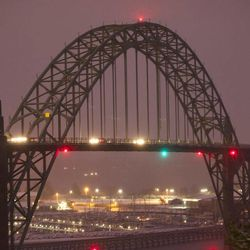 This Dec. 6, 2013 photo, shows the Yaquina Bay Bridge, Newport, Ore. A woman who appealed for money online to help care for her autistic son and disabled husband has been accused of throwing her 6-year-old boy to his death off the historic bridge on Monday, Nov. 3, 2014.