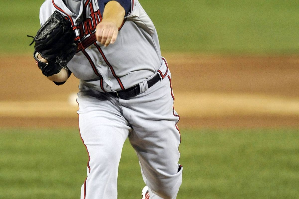 August 21, 2012; Washington, D.C., USA; Atlanta Braves starting pitcher Paul Maholm (17) pitches in the third inning against the Washington Nationals at Nationals Park. Mandatory Credit: Joy R. Absalon-US PRESSWIRE