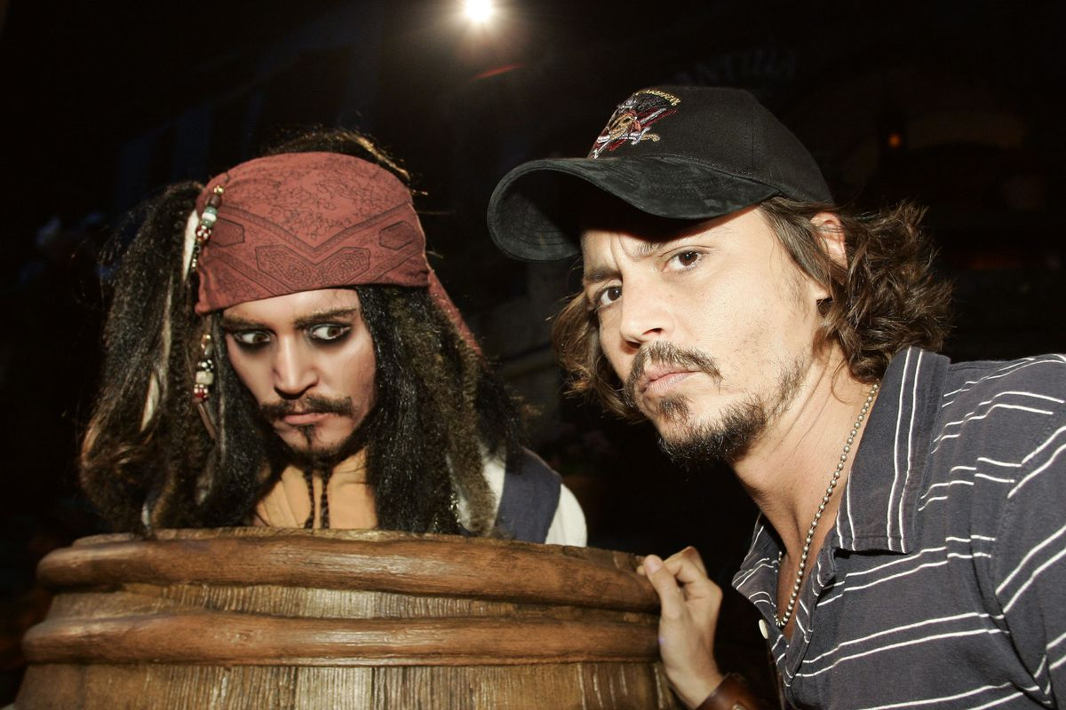 """Johnny Depp comes face to face with an Audio Animatronics version of Jack Sparrow at the premiere of Walt Disney Pictures' """"Pirates of the Caribbean: Dead Man's Chest"""" at Disneyland."""