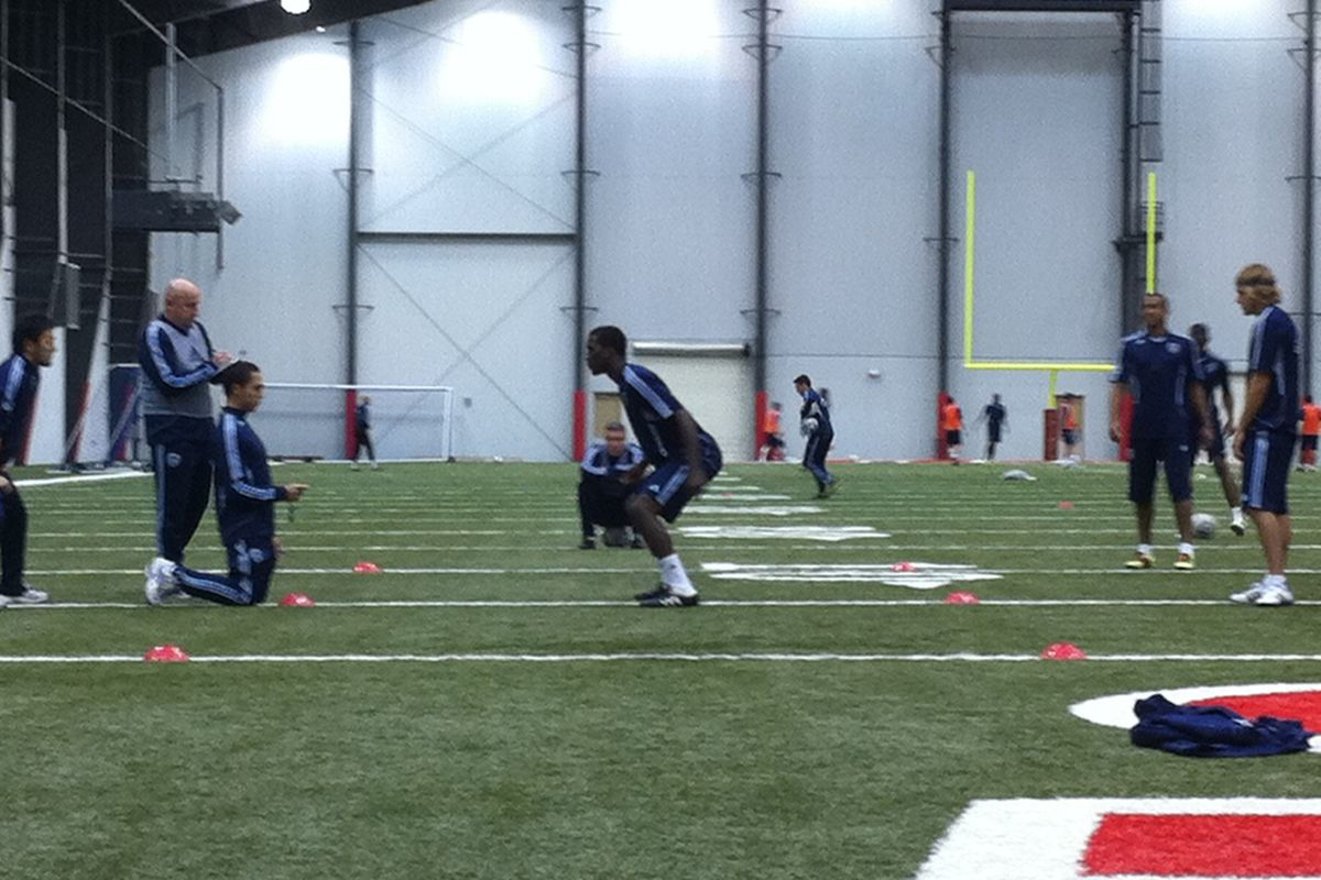 <strong>Sporting KC</strong>'s 2011 SuperDraft selection <strong>CJ Sapong</strong> prepares to take off prior to his agility test during Wednesday's training session.