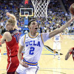 FILE - In this Jan. 21, 2017, file photo, UCLA guard Lonzo Ball, center, shoots as Arizona forward Lauri Markkanen, left, and center Chance Comanche defend during an NCAA college basketball game in Los Angeles. The 2016-17 college basketball season has been led by freshmen, from the cast of future NBA players at Kentucky to Ball and Markelle Fultz out west. (AP Photo/Mark J. Terrill, File)