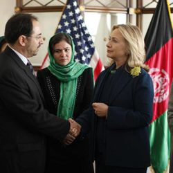 FILE - In this Thursday, Oct. 20, 2011 file photo, U.S. Secretary of State Hillary Rodham Clinton, front right, meets Salahuddin Rabbani during a Civil Society roundtable discussion at the U.S. Embassy in Kabul, Afghanistan. The son of a former Afghan peace council chairman killed by a suicide bomber has been elected to succeed his father as head of the group tasked with finding a political resolution to the decade-long war. A statement from the Afghan president's office said that the 70-plus members of the Afghan High Peace Council on Saturday elected Salahuddin Rabbani to lead the group.