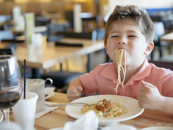 A kid enjoying pasta at Napa Flats