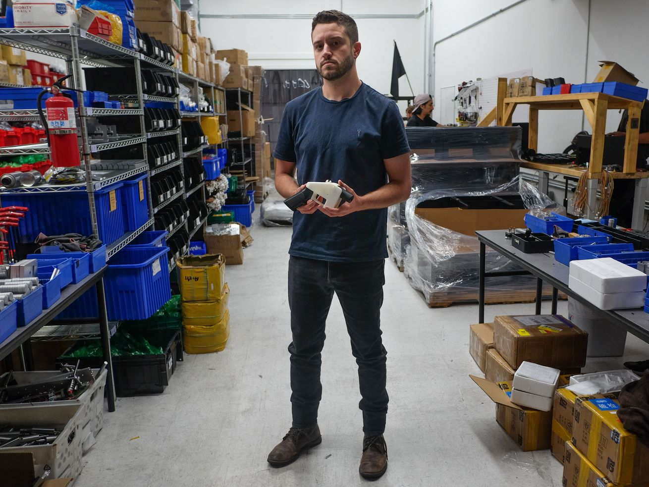 Cody Wilson, libertarian activist and owner of Defense Distributed, holds up a 3D-printed gun that he designed.