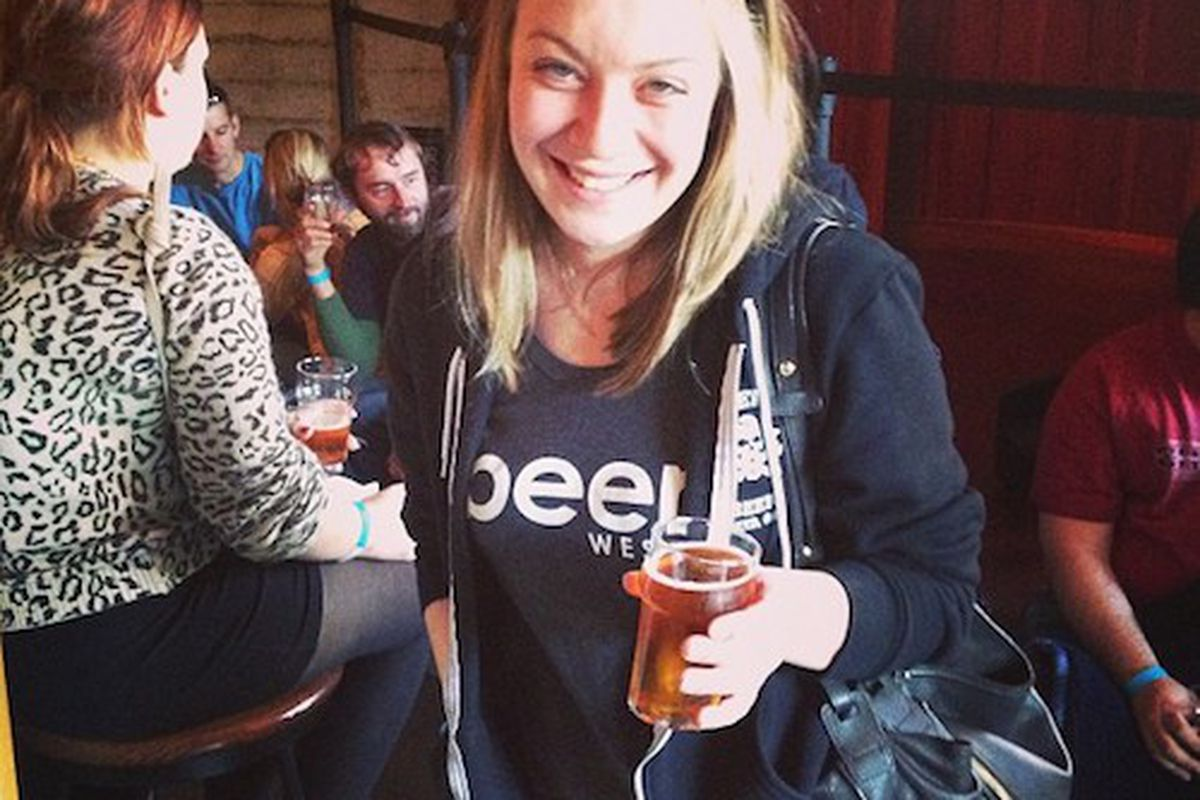 Emily Kingsbury sipping a Pliny the Younger.
