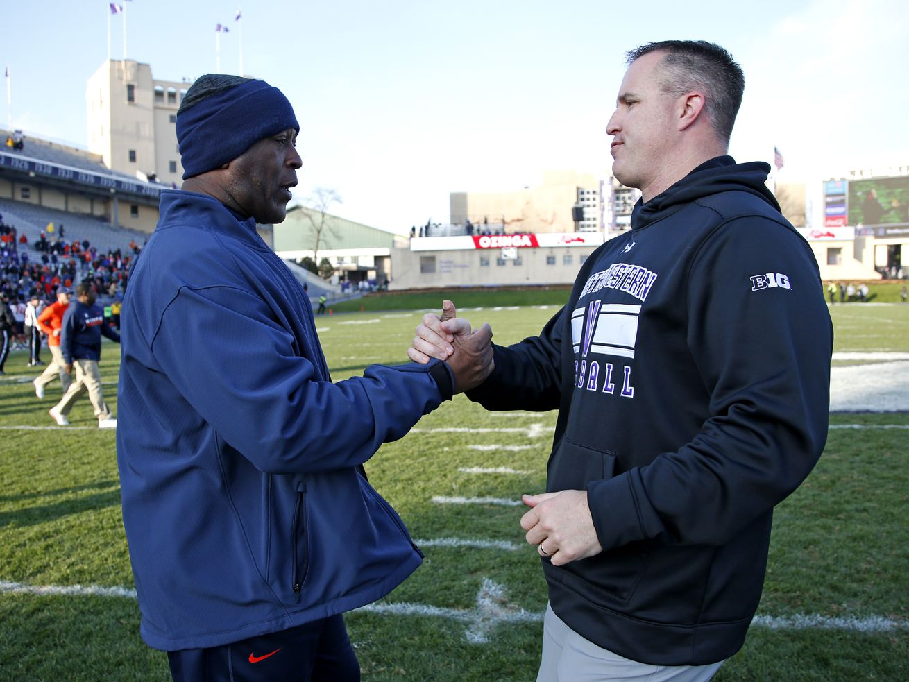 Illinois' Lovie Smith and Northwestern's Pat Fitzgerald after the Wildcats' 42-21 win in 2016.