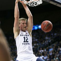 BYU forward Eric Mika goes up for a dunk at the Marriott Center in Provo Utah on Wednesday, March 15, 2017.