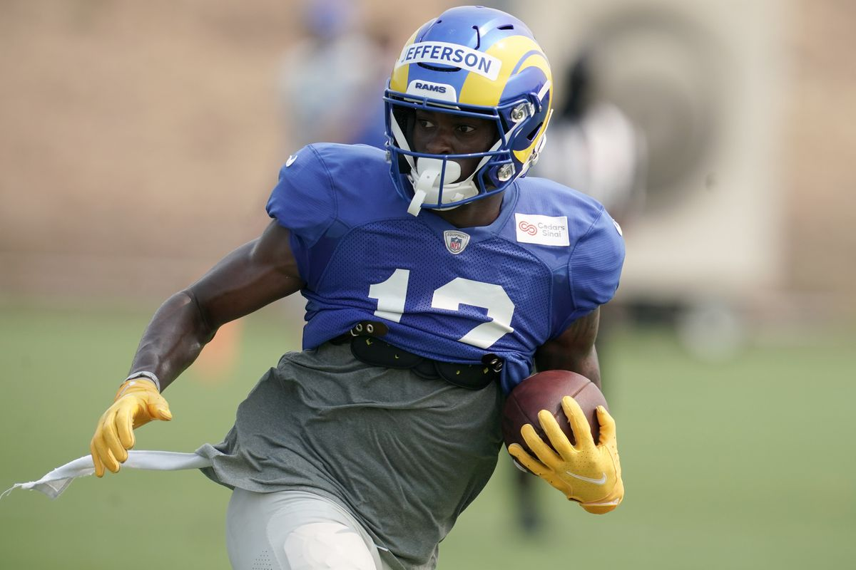 Los Angeles Rams receiver Van Jefferson carries the ball during training camp at Cal Lutheran University.