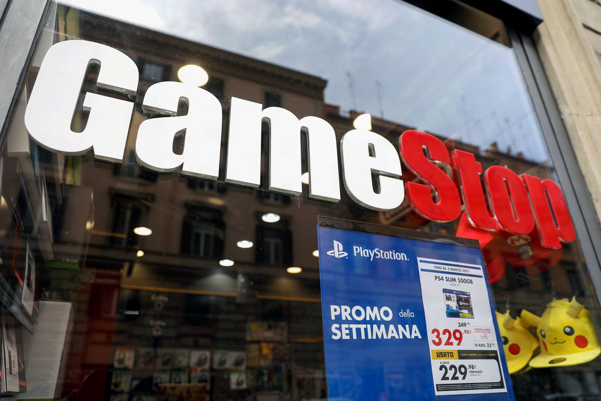 a photo of a GameStop window in Rome with a PS4 Slim promo