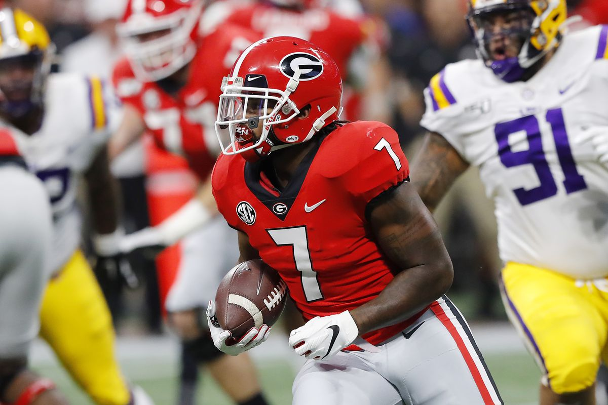 D'Andre Swift #7 of the Georgia Bulldogs runs with the ball in the first half against the LSU Tigers during the SEC Championship game at Mercedes-Benz Stadium on December 07, 2019 in Atlanta, Georgia.