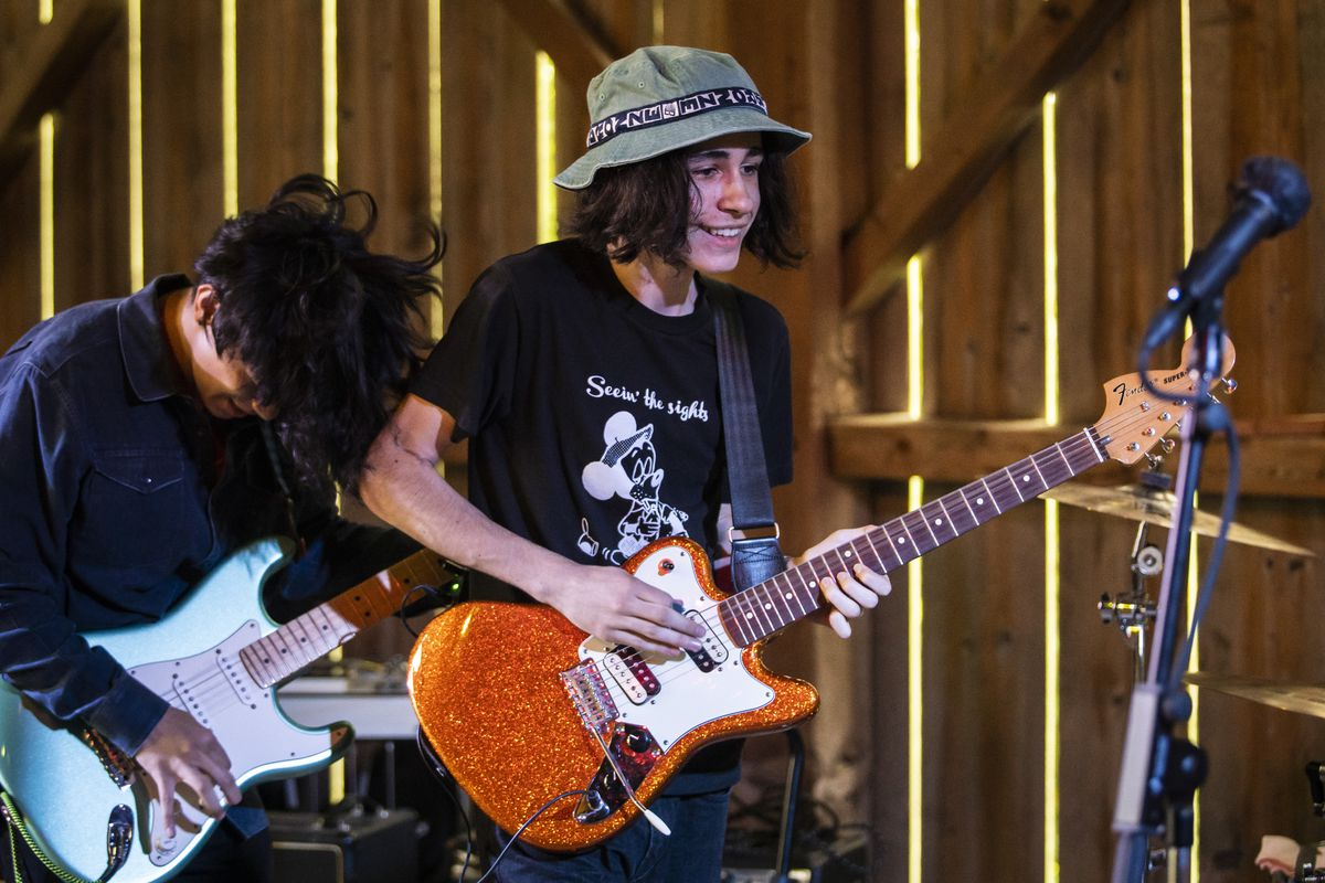 Rylan Wilder and his floppy hat playing with Monarchy Over Monday during the teenage Chicago band's comeback performance at the Postock music festival near Albany, Wisconsin, on July 30.
