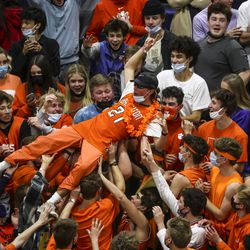 A Brighton fan crowd surfs as the Bengals stormed back and forced overtime against Orem in a second round boys 5A state basketball tournament game at Brighton High School in Cottonwood Heights on Friday, Feb. 26, 2021. Brighton defeated Orem in overtime and advanced in the tournament.