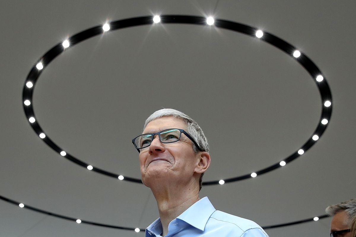 Apple CEO Tim Cook looks on during an Apple event in Cupertino, California.