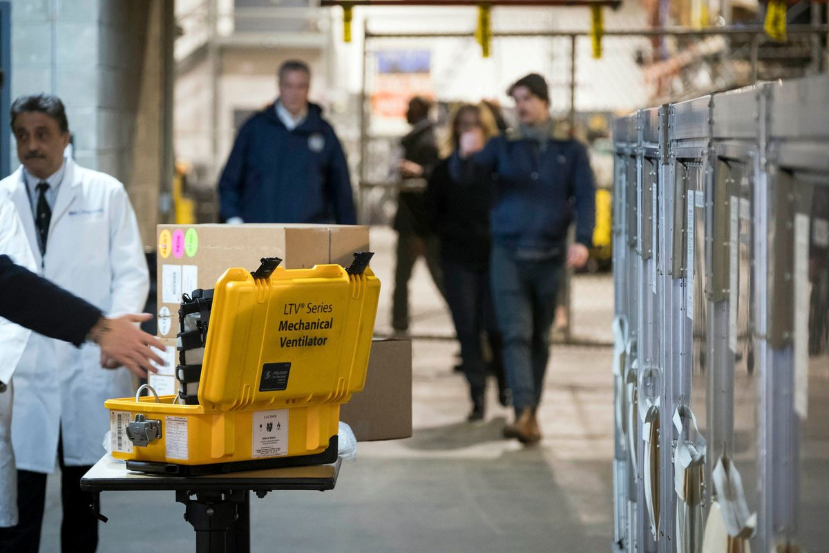 Mayor Bill de Blasio examines ventilators, which arrived at a New York City Emergency Management Warehouse, March 24, 2020.