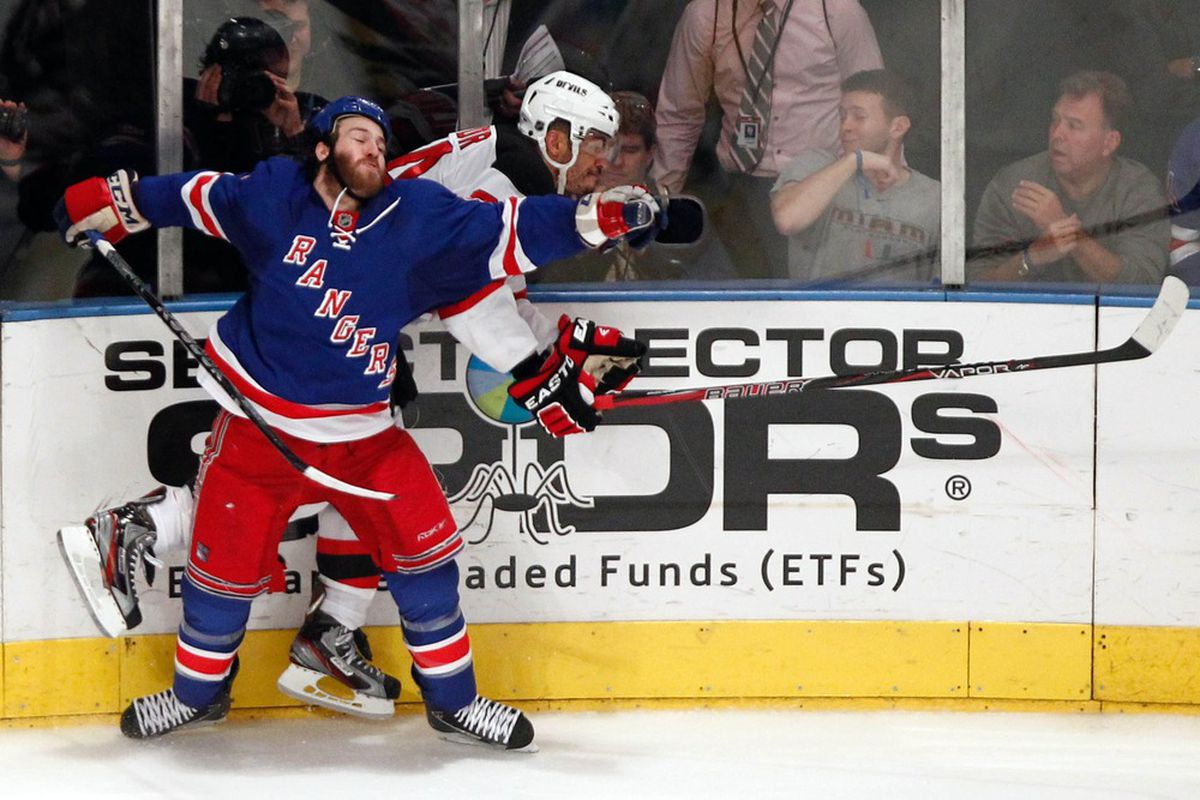 He's falling backward into his friend. It's a Prust exercise.