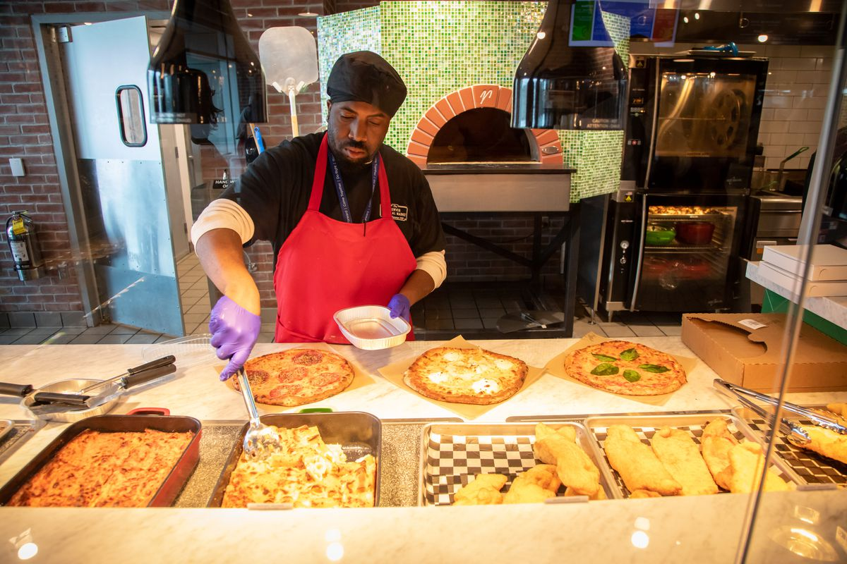 Pizza and pasta served at a counter at Denver International Airport