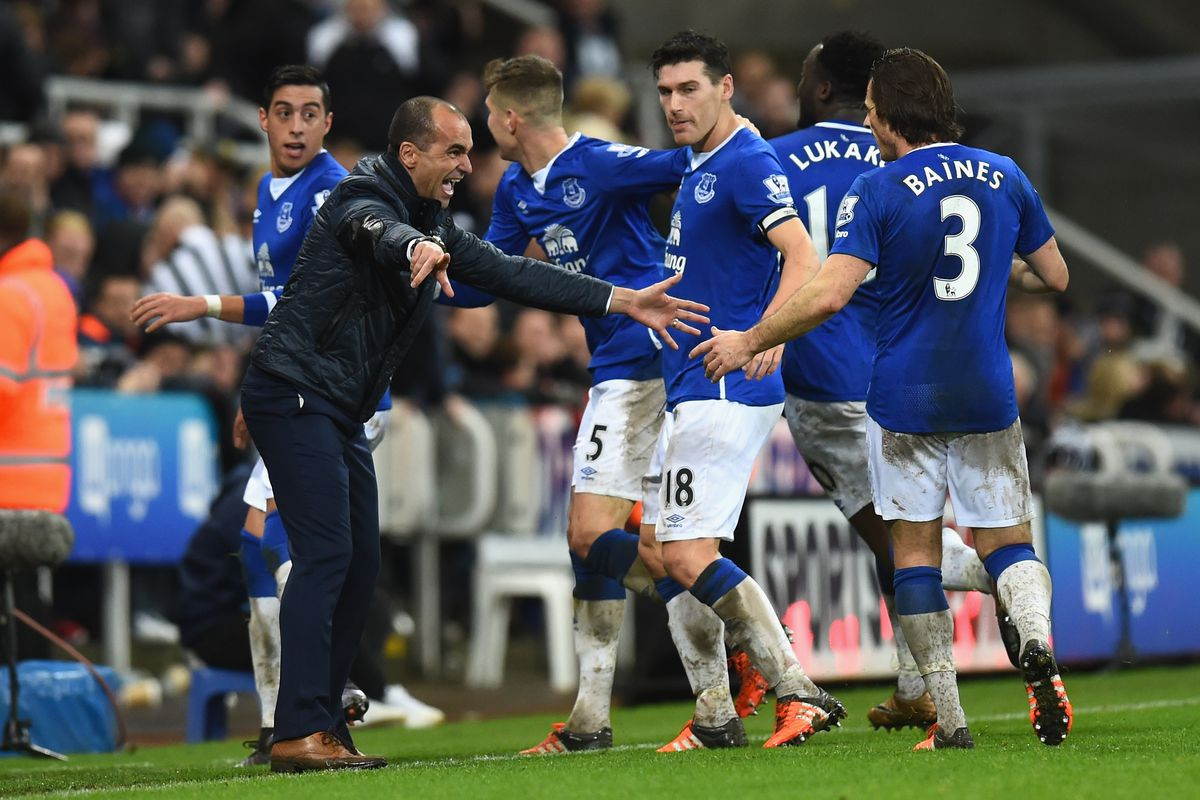 Roberto Martinez celebrates the game-winning goal with Gareth Barry (the best player on the pitch yesterday) and others.