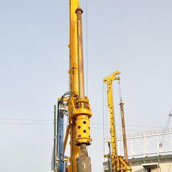 Triangle lot: machine pushing the steel beam down