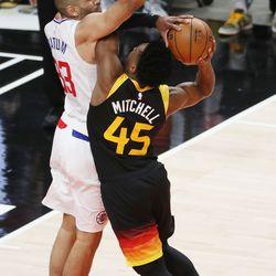 Utah Jazz guard Donovan Mitchell (45) drives on LA Clippers forward Nicolas Batum (33) during the NBA playoffs in Salt Lake City on Thursday, June 10, 2021. The Jazz won 117-111.