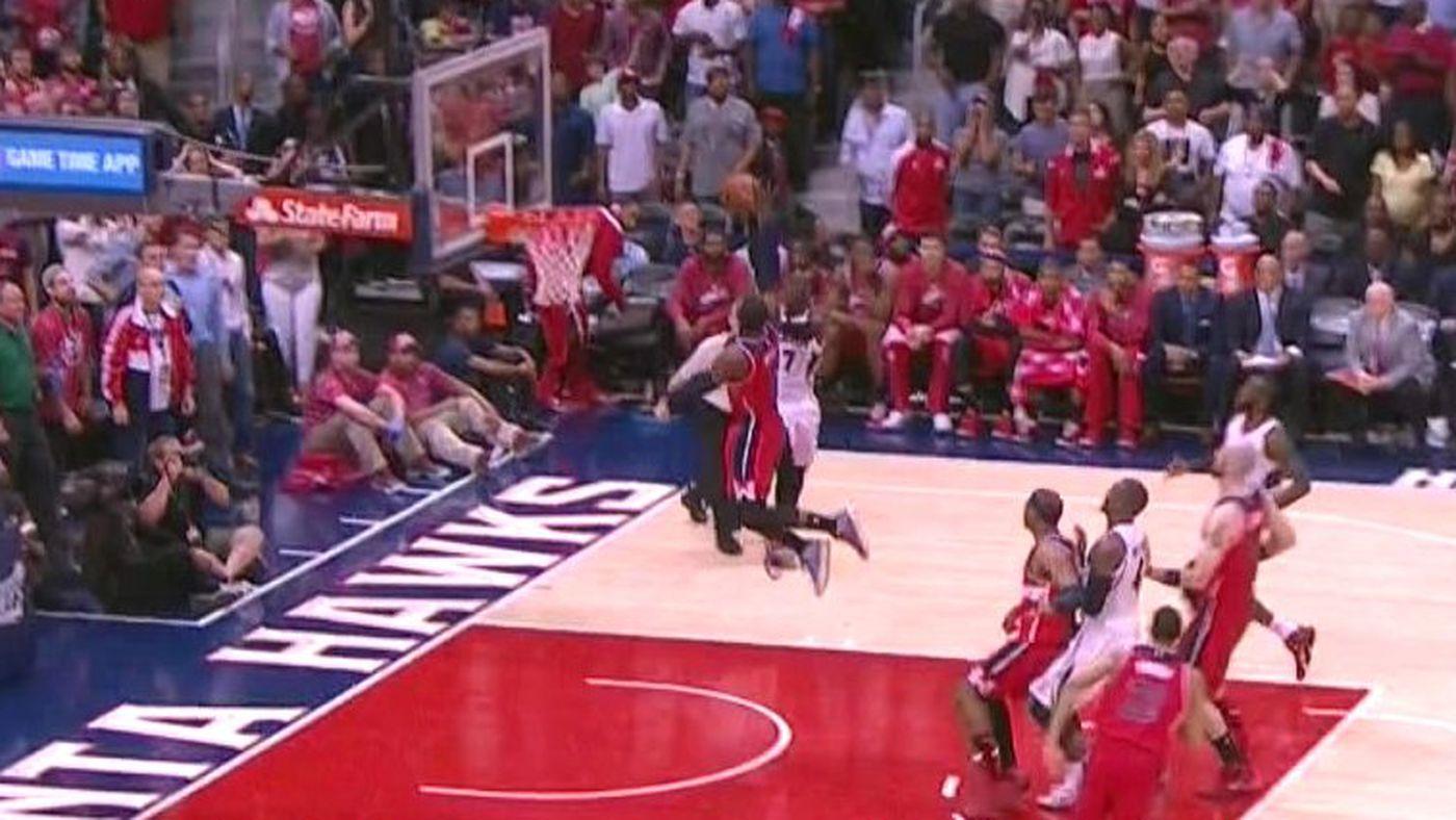 John Wall blocks a dunk like a superhero