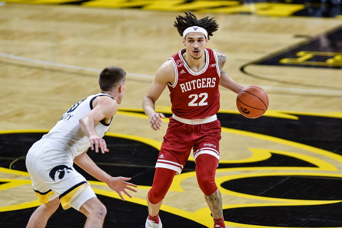 Rutgers Scarlet Knights guard Caleb McConnell is defended by Iowa Hawkeyes guard Joe Wieskamp during the first half at Carver-Hawkeye Arena.