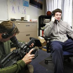 Jimmer Fredette talks to a national radio talk show while being filmed by an ESPN film crew in Provo on Jan. 27, 2011, for an upcoming ESPN All Access special.